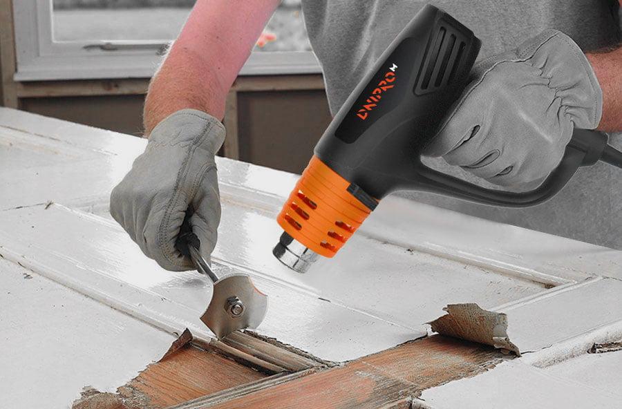 Використання будівельного фена для зняття фарби з дерева